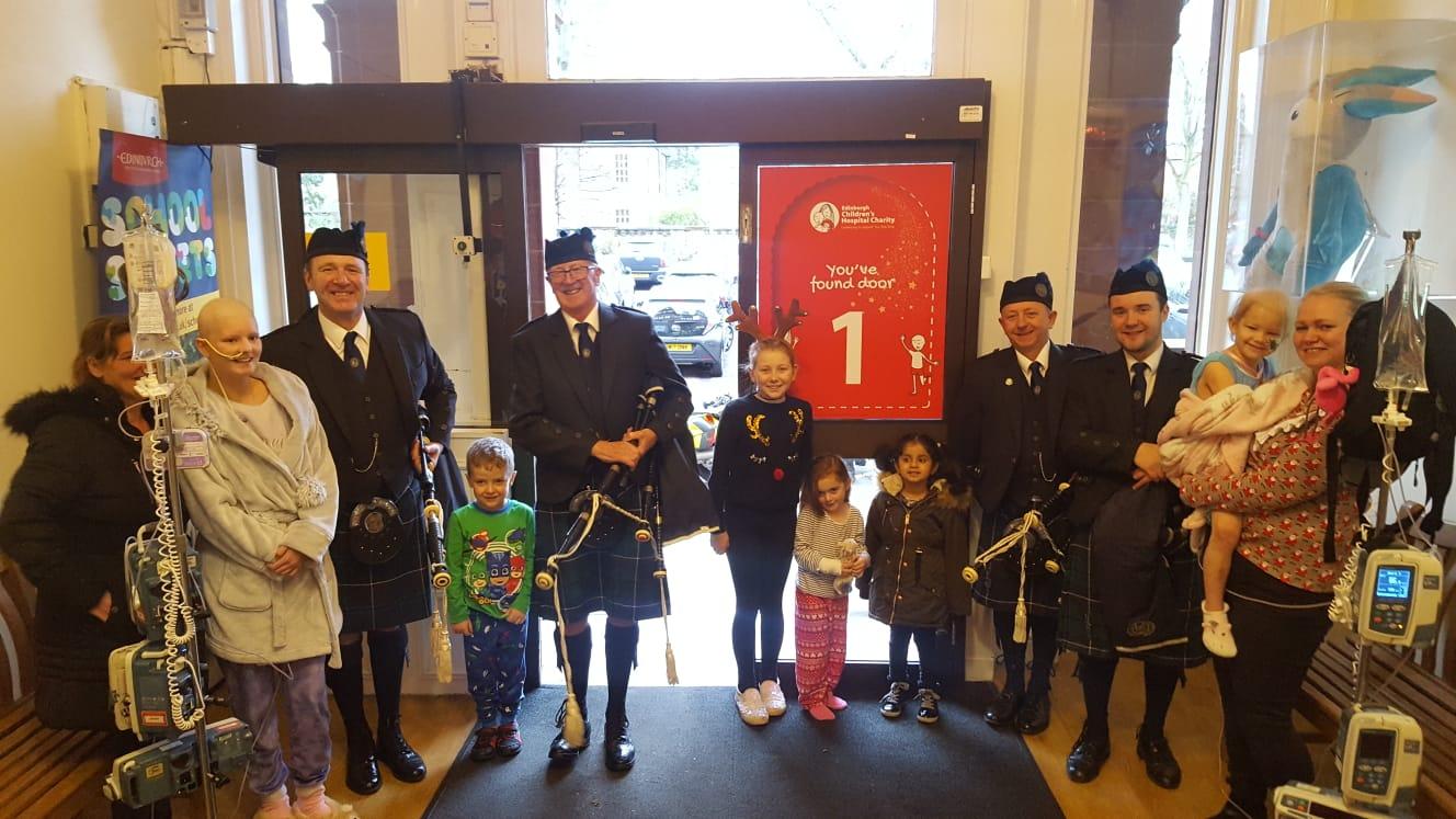 Haddington Pipe Band at the RHSCH as part of their living advent calendar | Charity PR