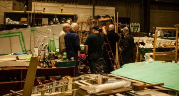 A group of from The Aviation Preservation Society Scotland are show working on a World War One aircarft model