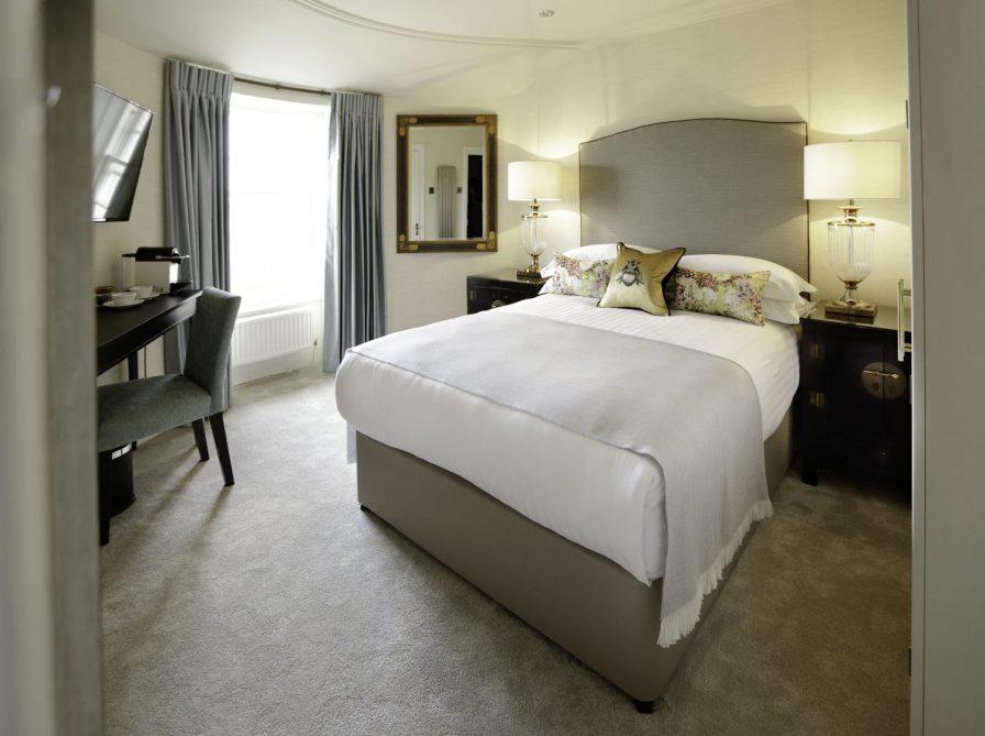 Hotel PR photograph of a bright bedroom at Nira Caledonia hotel in Edinburgh