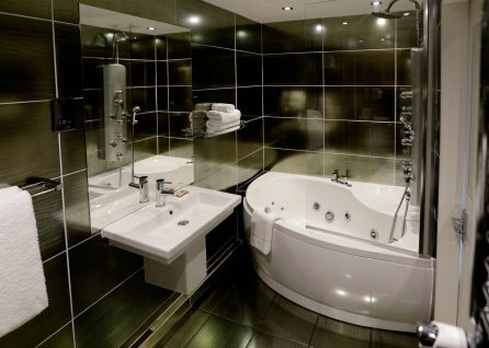 Hotel PR photograph of a modern bathroom finished with black floor and tiles at Nira Caledonia