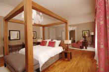Four poster hotel suite bed and glamorous interior design at Tigerlily Edinburgh - hotel PR phtoography