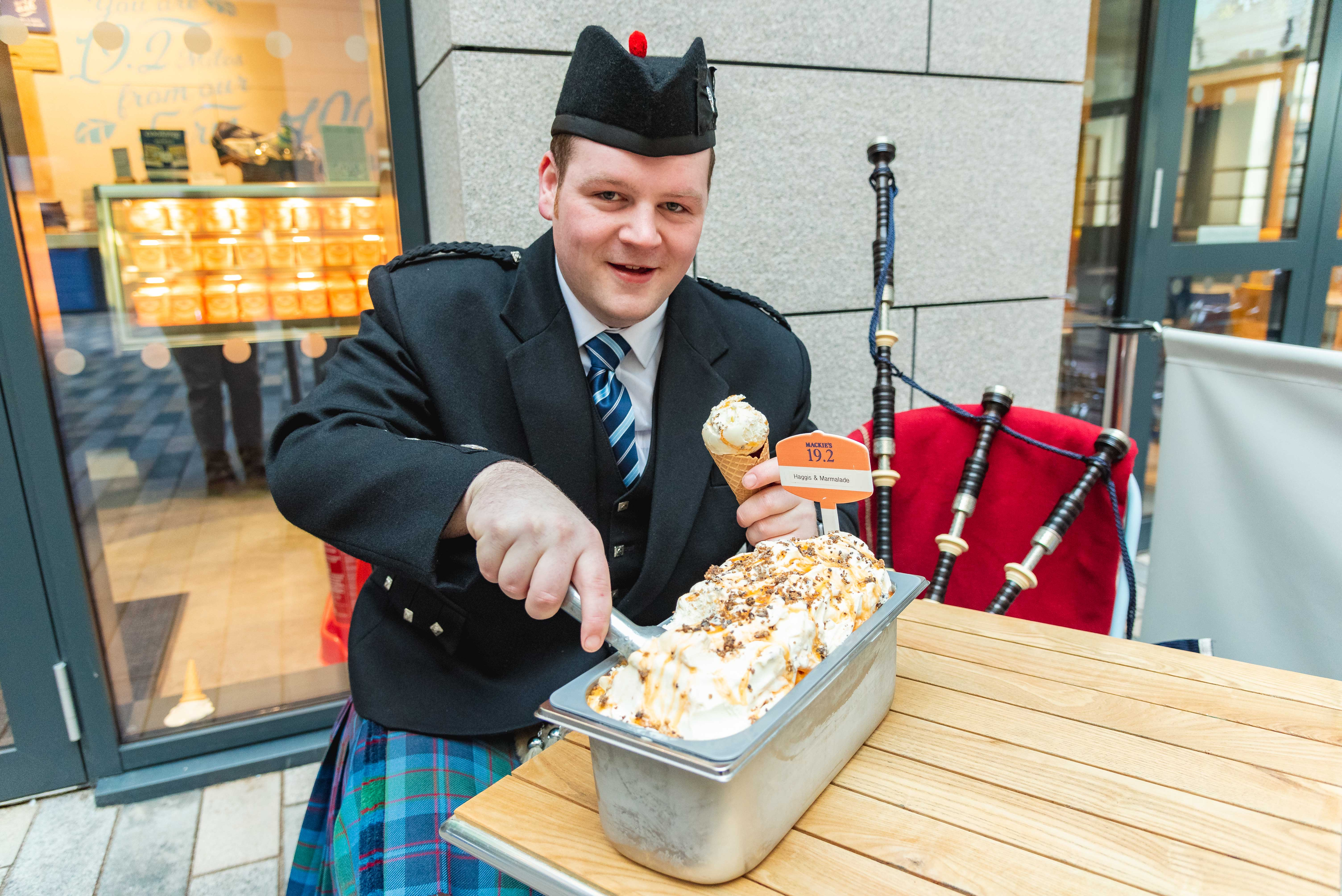 Piper Robert Reid scooping Haggis Ice Cream at Mackie's 19.2 in a food and drink pr photo