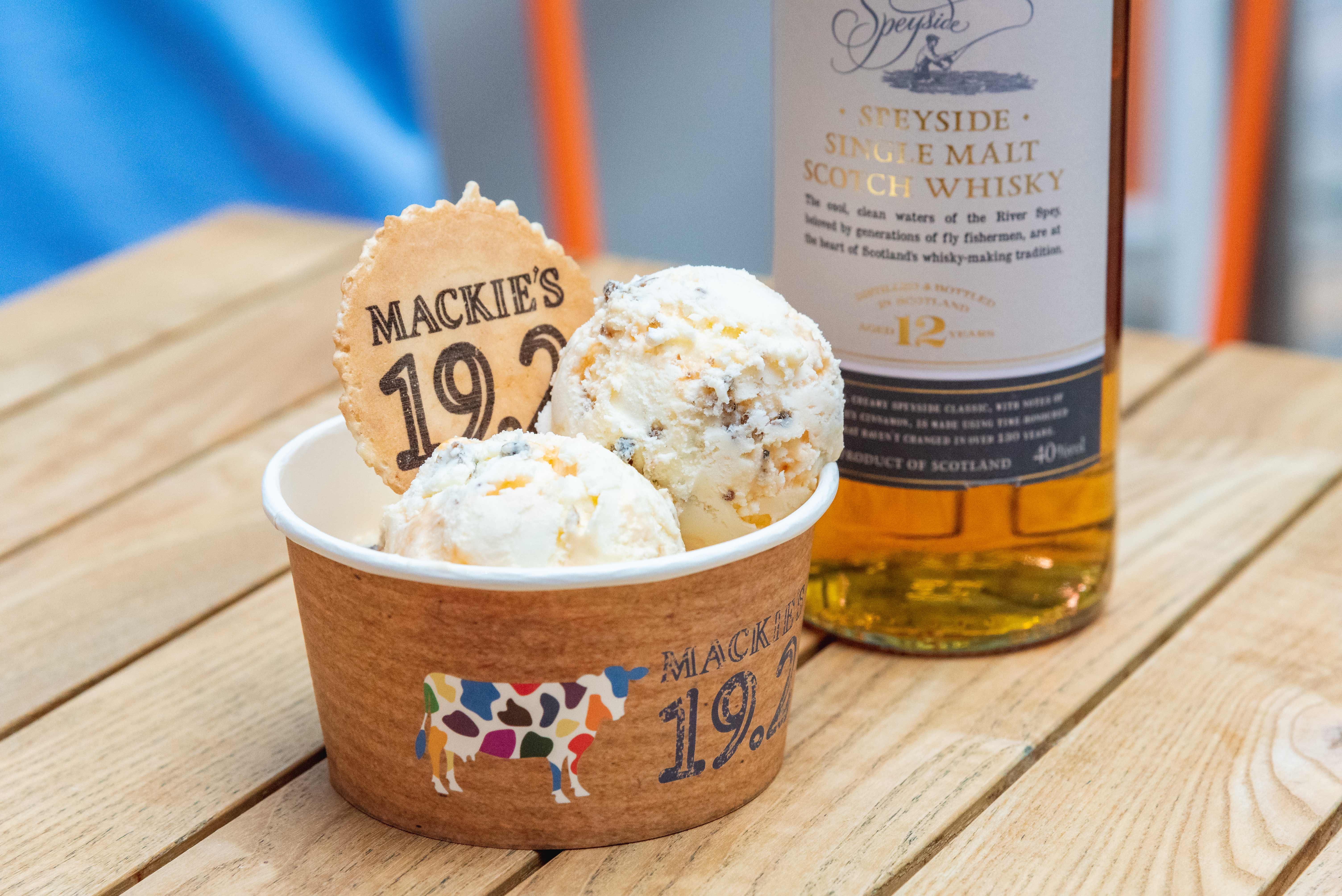 Serving tub of Mackie's 19.2's Haggis and Marmalade ice cream sat next to a bottle of whisky in a food and drink PR photo for Burns Night.