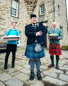 Food and drink PR photograph of a Scottish piper piping Mackie's haggis and marmalade ice cream in Aberdeen