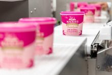 A food and drink PR photo of a tub of Mackies Rhubarb and Strawberry ice cream