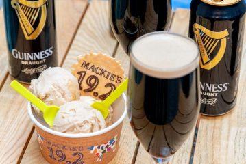 Scoops of the Guinness sorbet surrounded by pints of Guinness brandished with a 19.2 Mackie's wafer