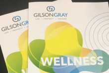 Legal PR photography of Gilson Gray Wellness booklets