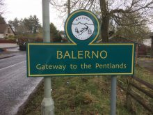 """Image shows Balerno's new green and yellow welcome signage, along with """"Gateway to the Pentlands"""" - installed thanks to CALA Homes 