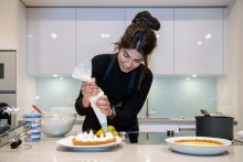 Ruby puts the finishing touches to her meringue pie in front of guests at The Crescent