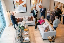 Guest listen as architect Richard Murphy gives a talk the inspiration for The Crescent