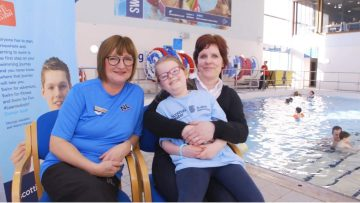 Learn to Swim Coach Mary Weir sat with Phoebe Lannigan and Sandra Lannigan poolside.