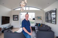A property PR image for CALA Homes of happy buyer Neil Davidson inside new penthouse at The Crescent