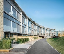 External image of CALA Homes The Crescent - a sweeping curve of glass fronted contemporary apartments. Property PR