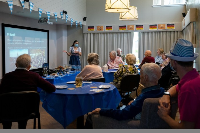 social care PR photography Cramond Residence Oktoberfest residents watching and learning about the German tradition