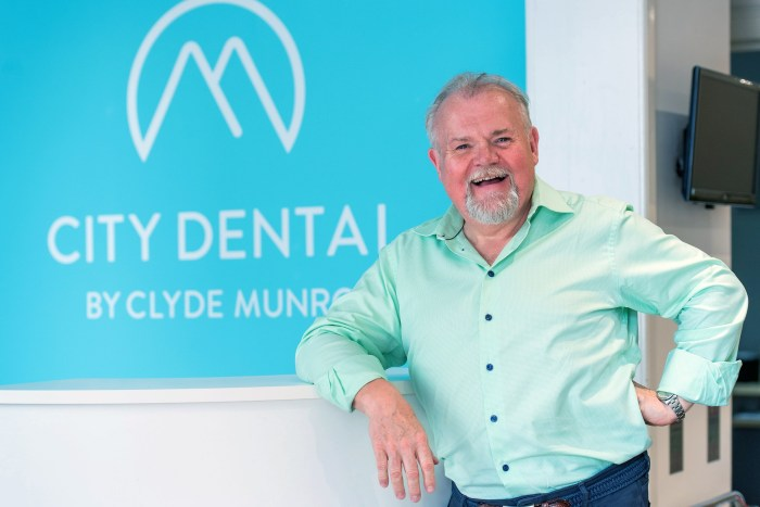 Health PR photography shot of Jim Hall with Clyde Munro logo, Clyde Munro Dental Group, CEO and Founder, Jim Hall and Jacqui Frederick