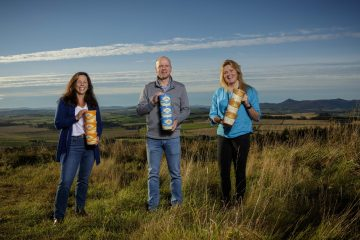 Property PR photography, Mackie family holding tubs, Mackie's of Scotland.