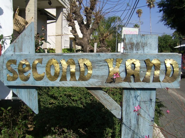 """store sign """"second hand store"""""""