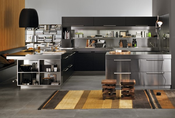 It's hard to tell at first whether this space is a kitchen or office. The cabinetry and furnishing are so modern with finishes in black and stainless steel.