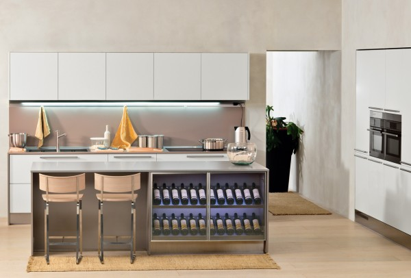 This classy kitchen space has a full wine rack built into the island. It adds to the aesthetics of the space and provides a show piece.