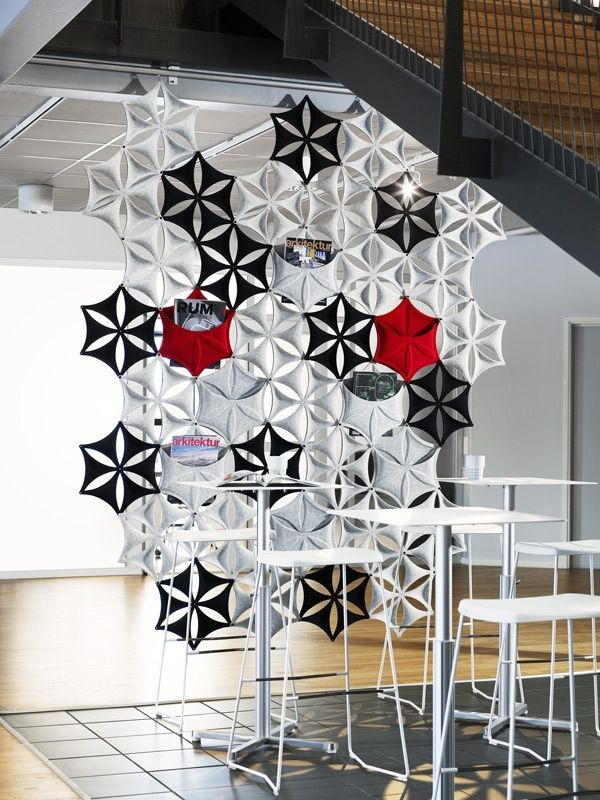 Part art installation, part partition, this bright snowflake design also has pockets for reading material or other décor.