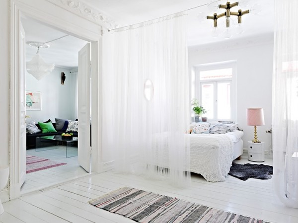 Gauzy white curtains don't do much to keep out noise, but sometimes the suggestion of division is enough to make a space more comfortable.