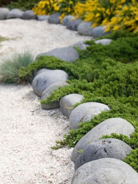 soften edges of rock edging with groundcover