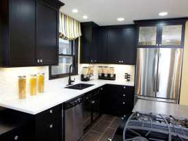 black kitchen cabinets which are godsend for hiding mess