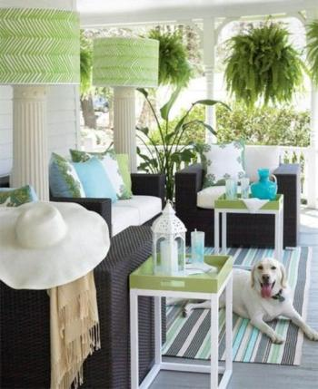 Coastal outdoor patio decorated with green details that create a space perfect for the pup!