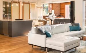 modern open plan kitchen with wood flooring