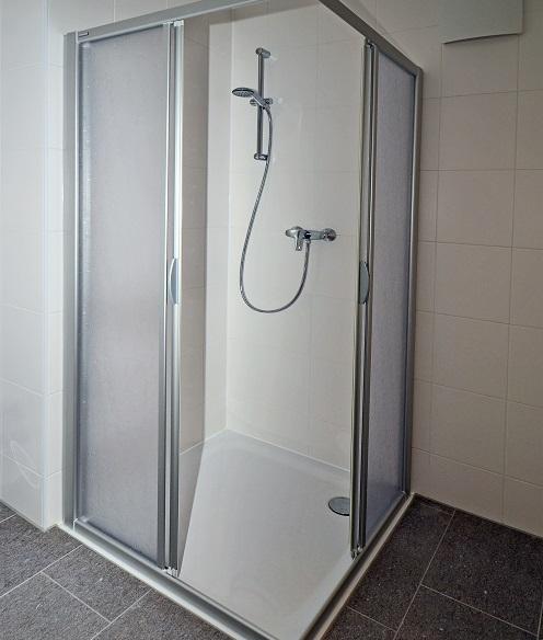 to install a fiberglass shower base