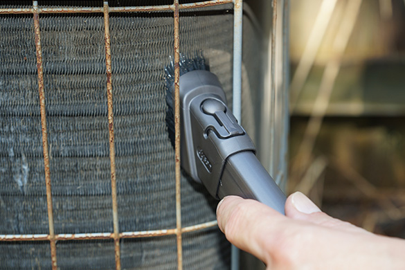 Vacuuming air conditioning condenser coil fins from outside