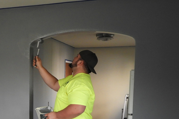 Painter painting trim on interior house paint project