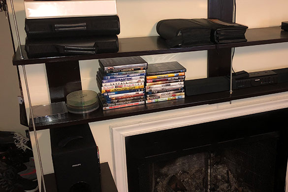 DIY wall mounted shelving unit built and anchored to surround a fireplace
