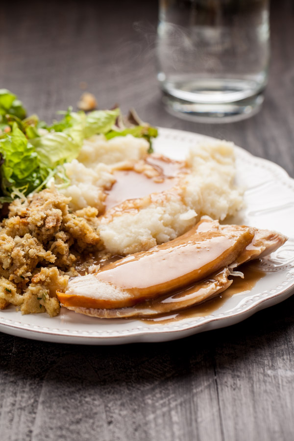 Oven Roasted Turkey with Mashed potatoes, gravy, stuffing, and salad