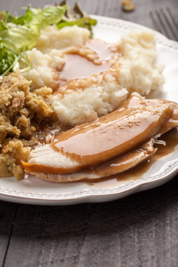 Oven roasted turkey with mashed potatoes, salad, stuffing, and gravy