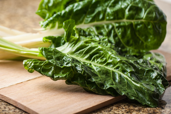 Swiss Chard on wooden boards