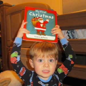 boy with my first christmas book