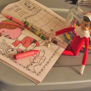 elf on shelf with coloring book