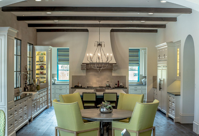 French Kitchen. Ivory French Kitchen with French chandelier and exposed ceiling beams. #FrenchKitchen #FrenchKitchen #FrenchChandelier #IvoryKitchen #Kitchen Platinum Series by Mark Molthan