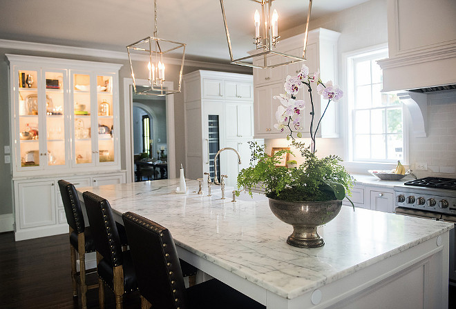 Marble island countertop. Classic white marble topping island in white kitchen. #Marblecountertop #islandmarblecountertop #whitemarble Artisan Design Studio