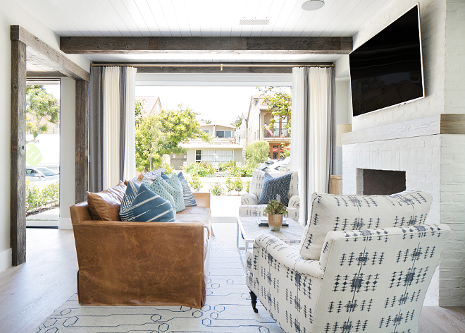 Bi-fold patio doors. La Cantina accordion doors provide a seamless transition from the living room to the front patio. #Bifolddoors #accordiondoors Patterson Custom Homes