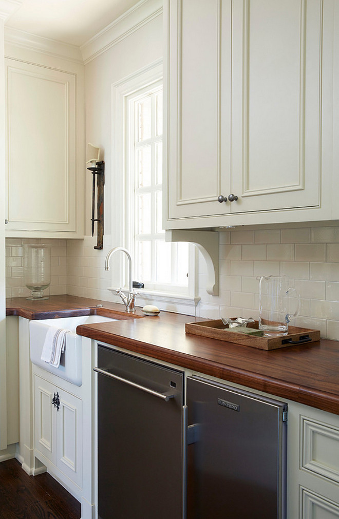 Traditional Off-White Kitchen with Brick Backsplash - Home ... on Backsplash For Black Countertops  id=67121