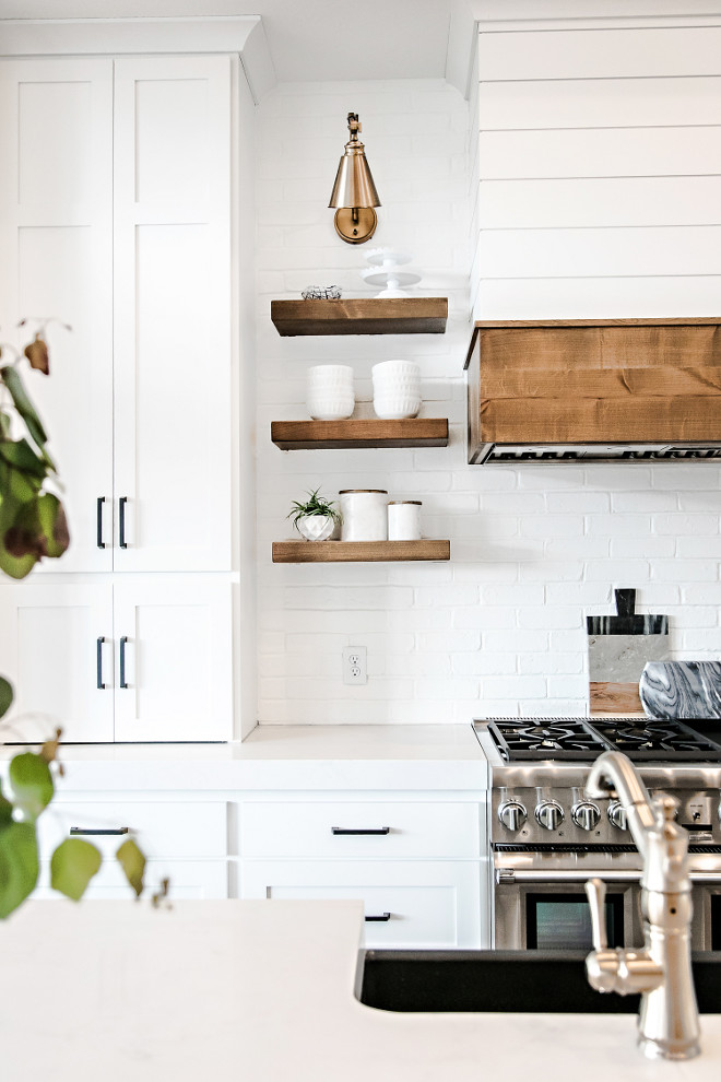 Wood Shelves. Kitchen Floating Wood Shelves, Painted Brick Backsplash, Brass Sconce and Shiplap Hood. Floating Wood Shelves. Kitchen Floating Wood Shelves. Kitchen Floating Wood Shelves. Kitchen Floating Wood Shelves #WoodShelves #KitchenShelves #FloatingWoodShelves #FloatingShelves #PaintedBrickBacksplash #BrassSconce #ShiplapHood Sita Montgomery Interiors.