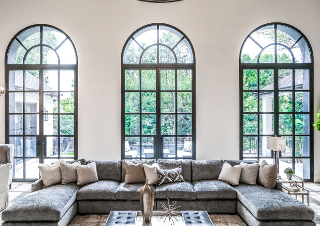 Black French Doors. Iron French Doors. Black Iron Doors. Living room Iron Doors. This exquisite home also features three 15'x7' iron French doors. #IronDoors #blackdoors Tree Haven Homes. Danielle Loryn Design