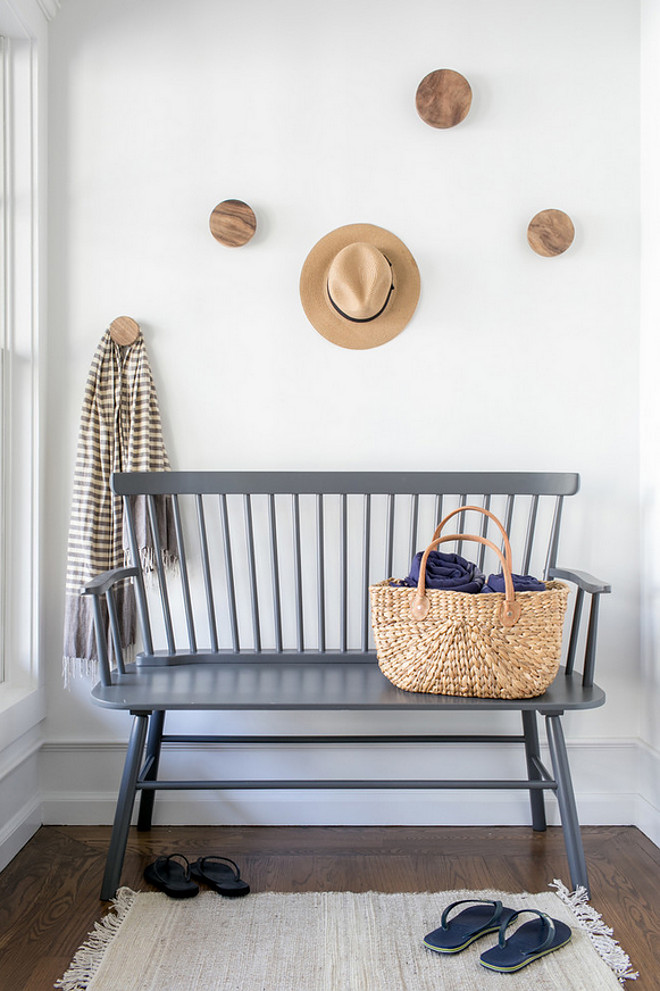 Casual Entry Bench Ideas. Casual Entry Bench. A grey bench and wooden hooks add a casual feel to this entry. Casual Entry Bench Ideas #CasualEntry #entry #Bench #entrybenchIdeas Chango & co