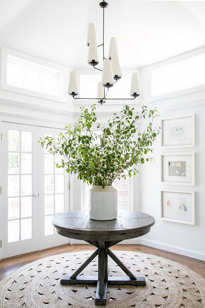 Modern Farmhouse Foyer. Modern Farmhouse Foyer features round driftwood table and modern chandelier from Circa Lighting #foyer #modernfarmhouse #farmhousefoyer #farmhouse #circalighting #modernchandelier Chango & Co.