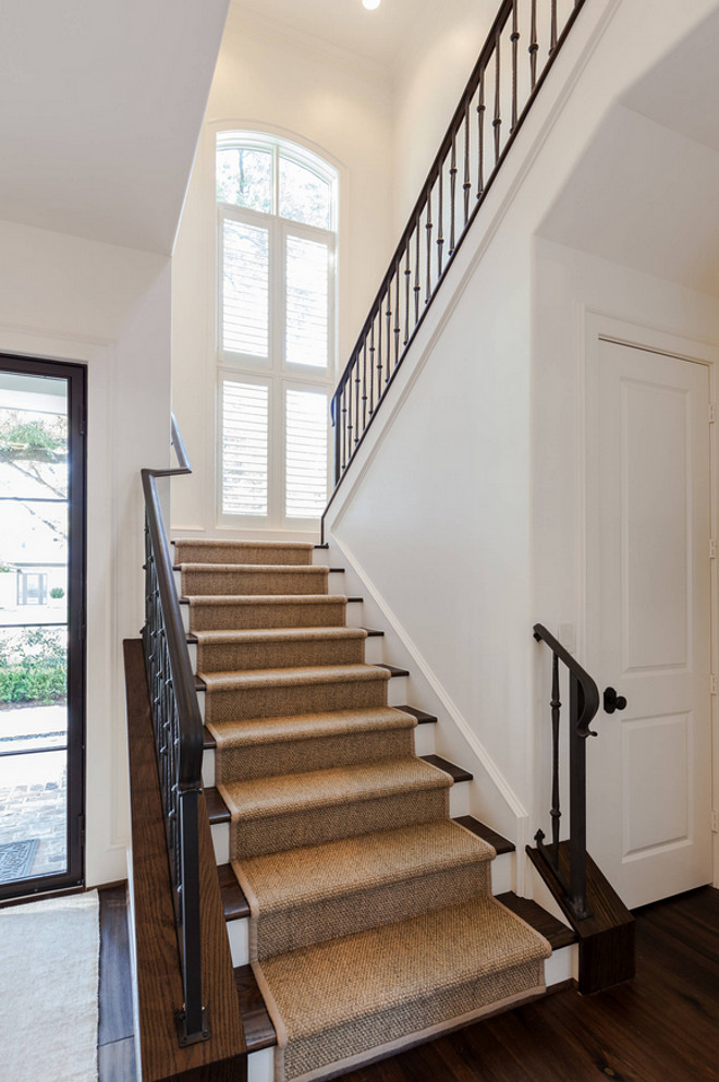 Stair runner. Sisal stair runner. Stair features sisal runner, dark Oak hardwood floors and metal railing. #stairRunner #runner #sisalrunner #metalrailing #darkhardwood
