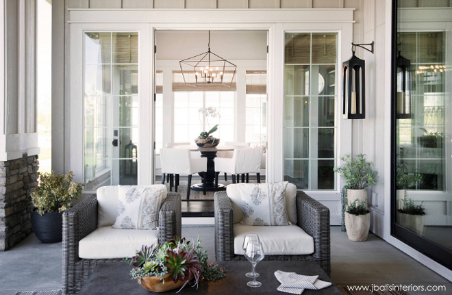 Back porch. Kitchen dining area opens to covered back porch with comfortable outdoor furniture and beautiful decor. Judith Balis Interiors