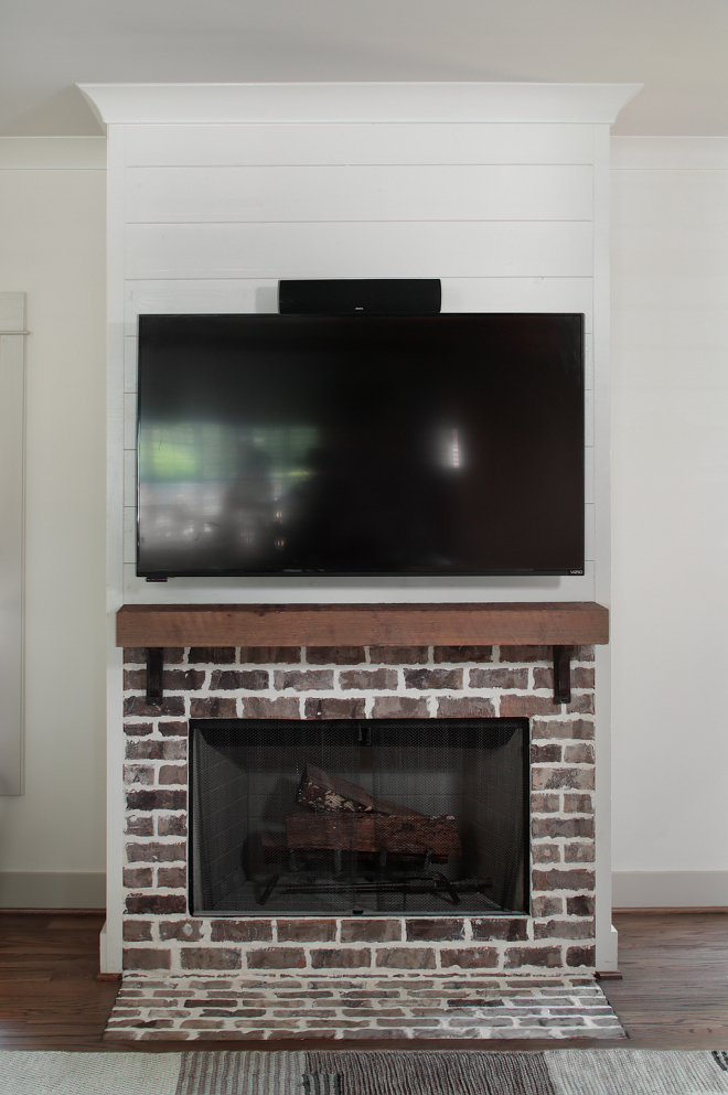 Brick fireplace timber mantel and shiplap. This farmhouse-style fireplace features exposed brick and custom Cedar mantel and shiplap. Brick fireplace timber mantel and shiplap. Brick fireplace timber mantel and shiplap. Brick fireplace timber mantel and shiplap. Brick fireplace timber mantel and shiplap #Brickfireplace #timber #mantel #shiplap Willow Homes
