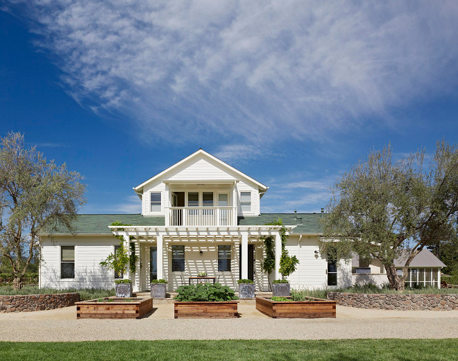 Cream white farmhouse exterior paint color Siding Paint Color Navajo White OC-95. Home Bunch's Best White Benjamin Moore Paint Colors. Jennifer Robin Interiors.